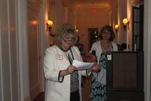 Karen Burns, Executive Director and Carol Costello, Volunteer Director make presentations at a fundraiser.
